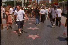 Hollywood Walk of Fame, stars on sidewalk, people - stock footage