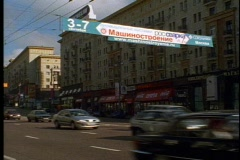 Traffic, with banners, and Cyrillic signs, crushed, Stock Footage