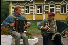 Faces of Russia, two accordion players, Stock Footage
