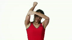 MS Woman stretching, against white background / Orem, Utah, USA Stock Footage