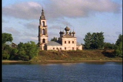 Volga River POV, passing onion dome church, Stock Footage