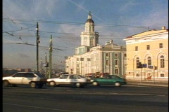 St. Petersburg, traffic, passes in front, tower bldg bkgd. - stock footage