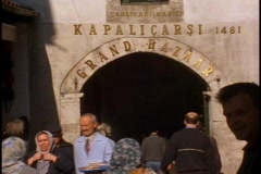 Gate to the Grand Bazaar, people past in front - stock footage