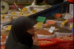 Woman in market in black burka  face - stock footage