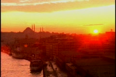 Sunset, mosques, minarets,  very orangey silhouette Stock Footage