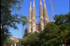 Barcelona, Gaudi, Sagrada Familla Church,  tilt up 4 towers, crane Stock Footage