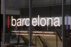 """Building with glass wall, large """"Barcelona"""" sign, people reflected Stock Footage"""
