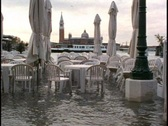 Stock Video Footage of Venice Flood at High Tide, café chairs standing in water,