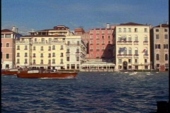 Grand Canal of Venice from shore, still, boats passing in front, bright Stock Footage
