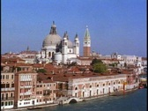 Stock Video Footage of Venice POV along the canals, sunny, Salute Church and Campanile