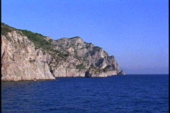 Isle of Capri, end of the Island, POV passing to open sea Stock Footage