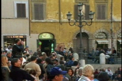 People on steps, orange house, lamp post,  moody, very Roman Stock Footage