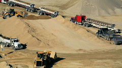 Bulldozers putting dirt in trucks Stock Footage