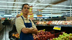 Grocer looking at camera Stock Footage