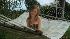 Girl sitting on a hammock Stock Footage