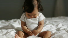 Baby on a bed Stock Footage