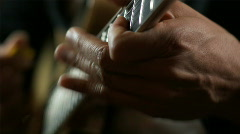 Close up of hands playing a guitar Stock Footage