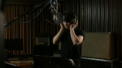 Man in a recording studio Stock Footage