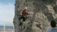 A Guy Climbing a Rock Wall 1 Stock Footage