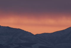 sunset over snowy mountains - stock footage