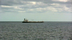 An Awesome Cargo Ship on the Ocean Under Beautiful Clouds 1 Stock Footage