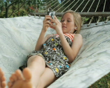 girl in a hammock listening to an iPod - stock footage