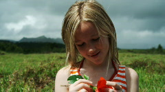 Girl holding a flower Stock Footage