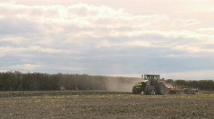 Wide shot of tractor and discs Stock Footage