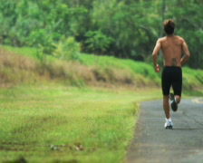 man jogging on the side of the road - stock footage