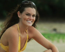 young woman on the beach - stock footage