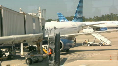 A Flight Attendant Walks Up the Stairs of an Airline Jet - stock footage