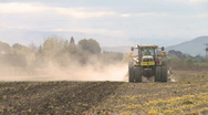 Tractor cultivating front on view Stock Footage