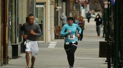 People running a marathon Stock Footage