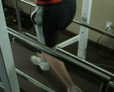 Woman running on a treadmill in a harness Stock Footage