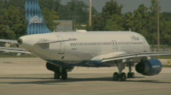 An Airline Jet Goes Out Onto The Runway To Take Off 2 Stock Footage