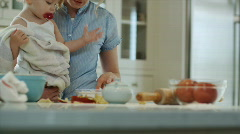 mother and baby cooking in the kitchen - stock footage