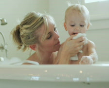 Mother and baby taking a bubble bath Stock Footage