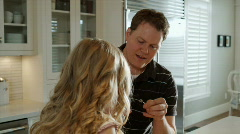 Father teaching a daughter to thread something Stock Footage