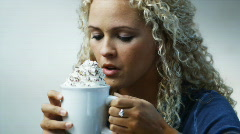 Woman drinking hot chocolate Stock Footage