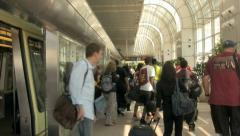 A Crowd of People Get off the Shuttle on their way to the Airport Terminal 1. Stock Footage