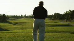 Golfer about to tee off Stock Footage