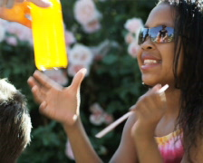 Girl drinking orange soda with a straw Stock Footage