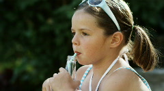 Girl drinking a soda pop Stock Footage