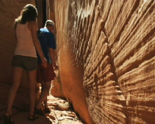 Hikers walking through narrows Stock Footage