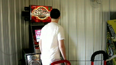 Male playing both mats on DDR Stock Footage