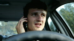 Man driving car talking on cell phone - stock footage