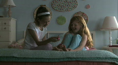 girls painting nails at a sleepover - stock footage