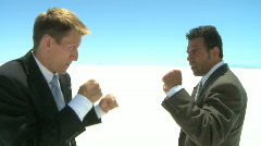 Two businessmen fighting Stock Footage