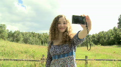 Woman taking a photograph of herself Stock Footage