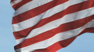 Large oversized American flag blowing in the wind Stock Footage